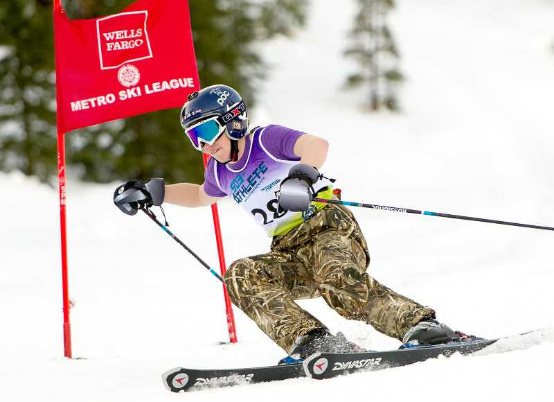 CONTRIBUTED PHOTO -- MIKE JULIANA - Dawson Wells turns the corner on the giant slalom during the final Metro League Ski Race of the season Saturday at Mt. Hood Meadows. Wells led Newberg with a 16th-place finish after a combined time of 47.57 seconds.