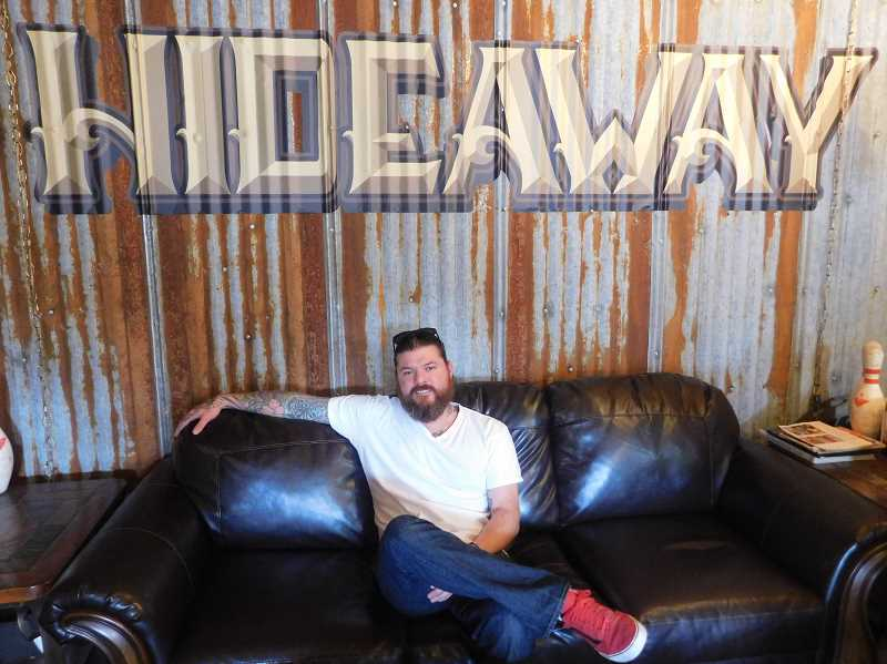 ESTACADA NEWS PHOTO: EMILY LINDSTRAND - Jake Ellzey is the owner of the Hideaway Tattoo Parlor.