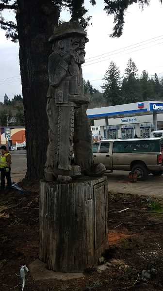 CONTRIBUTED PHOTO: MELANIE WAGNER - On Friday, March 2, the logger statue was temporarily moved away from City Hall so it could be repaired. It will return in the spring.