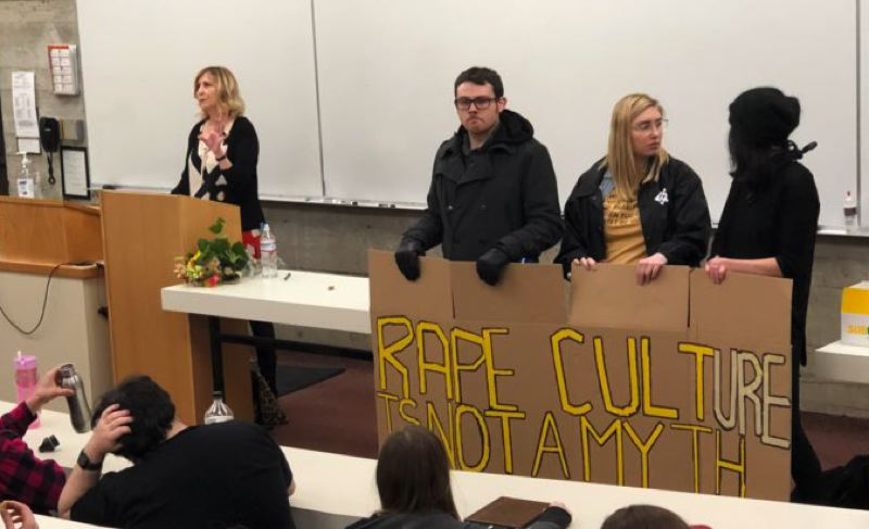 COURTESY: ANDY NGO - Lewis & Clark College students protest at a lecture by Christina Hoff Sommers, a conservative lecturer on feminism.
