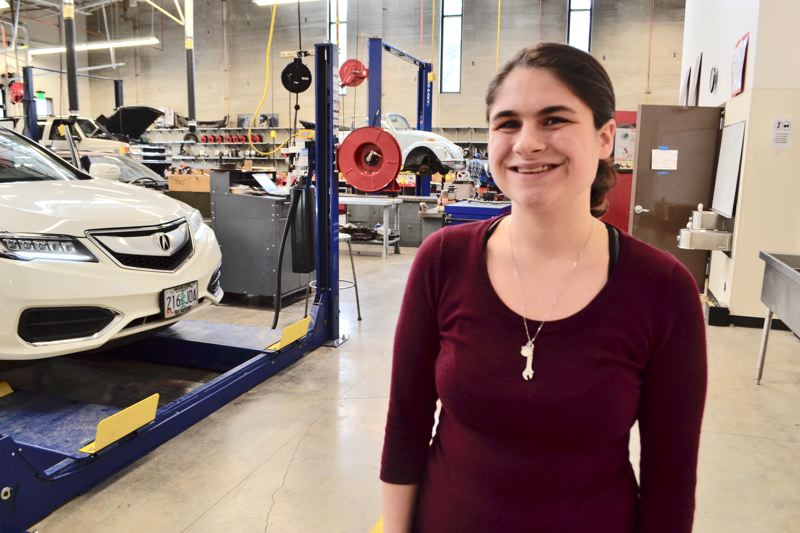 POST PHOTO: BRITTANY ALLEN - Mimi Van Tuyl, 17, has studied automotive technology since she was a sophomore at Sandy High School