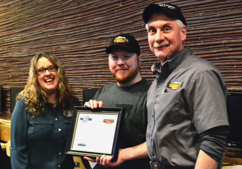 POST PHOTO: BRITTANY ALLEN - Sandy Area Chamber of Commerce Director Khyrs Jones presented General Manager Dale Rasmussen and Store Manager Ben Kolibaba with a plaque and a certificate for free advertising with the Chamber at the February Lunch and Learn meeting.
