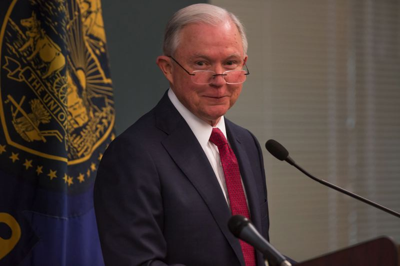JONATHAN HOUSE/PORTLAND TRIBUNE - U.S. Attorney General Jeff Sessions speaks at the U.S. Citizenship and Immigration Services office in Northwest Portland Sept. 19, 2017.