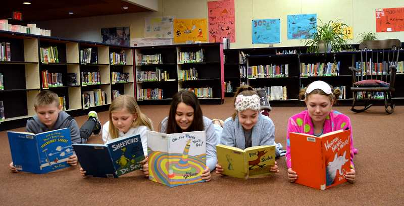 PIONEER PHOTO: CINDY FAMA - Colton Elementary's student council members are from left to right: Landon Stover (treasurer),  Rylee Beach (recording secretary), Taylor Quintana (president),  Emerson Collins (public relations), Addison Hordichok (vice president). They Dr. Seuss books to prep for the all-school assembly to honor Dr. Seuss and his books.