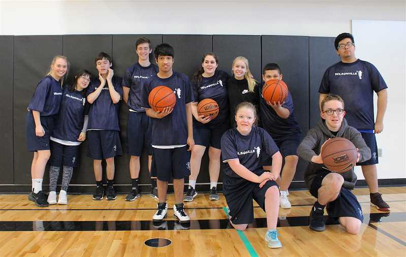 REVIEW PHOTO: SAM STITES - Wilsonville High School's Unified Basketball team poses for a photo before one of its games Saturday.