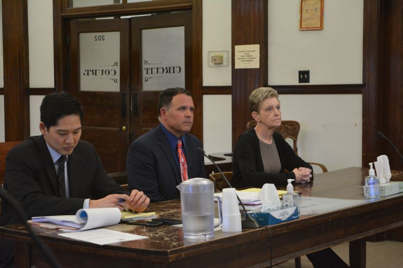 SPOTLIGHT PHOTO: COURTNEY VAUGHN - Linda Hald (far right) appears in Columbia County Circuit Court Wednesday, March 7 alongside her attorney, Michael Staropoli (center) and prosecuting attorney John Tseng.