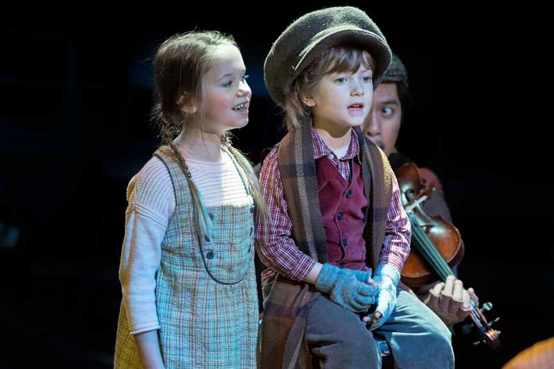 PHOTO COURTESY OF BRUD GILES PHOTOGRAPHY - Lake Oswego's Lauren Clark (left) is pictured here in one of her three roles during Portland Playhouse's production of 'A Christmas Carol.'