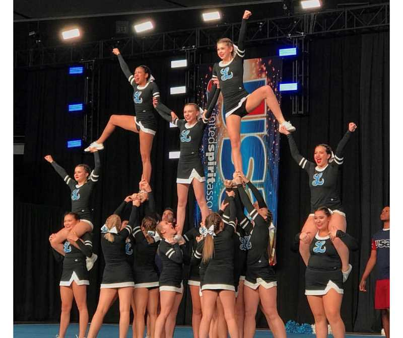 SUBMITTED PHOTO: CHRISTINE COOPER - Lakeridge High School cheerleaders perform at the USA Spirit Nationals last week in Anaheim, where they competed against teams from across the country and captured ninth place in their division.