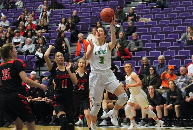 TIDINGS PHOTO: MILES VANCE - West Linn senior Lexie Pritchard goes up to score during her team's 42-32 win over North Medford in the quarterfinals of the Class 6A state basketball tournament at the Chiles Center on Wednesday.