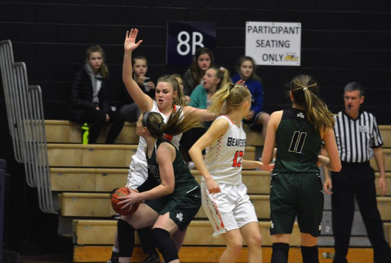 TIMES PHOTO: MATT SINGLEDECKER - Beaverton sophomore Laura Erikstrup and the Beaver girls basketball team beat Sheldon in the Class 6A semis.