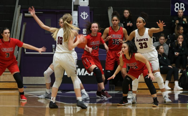 PAMPLIN MEDIA: JIM BESEDA - Southridge's  McKelle Meek (10) looks to pass the ball as Clackamas defenders (left to right) Elly Bankokfier, Savannah Duarte, Ciara James and Bri Phiakahmngon clog up the lanes during Wednesday's OSAA Class 6A girls' basketball quarterfinal game at the Chiles Center.