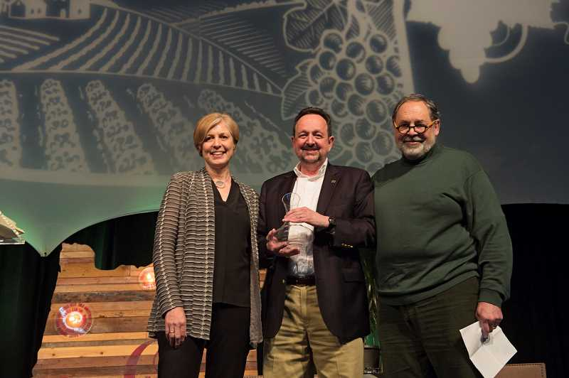 SUBMITTED PHOTO: CAROLYN WELLS KRAMER  - Dr. Tom Hellie, center, from Linfield College accepts the Industry Partner Awar at the 2018 Oregon Wine Symposium held Feb. 21 in Portland. With him are Ellen Brittan from Brittan Vineyards and Doug Tunnelol form Brick House Wines.