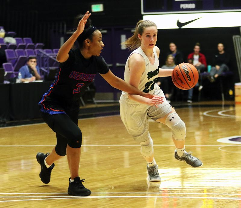 DAN BROOD - Tigard sophomore Delaney Leavitt (right) looks to dribble past Benson's Ciera Ellington.