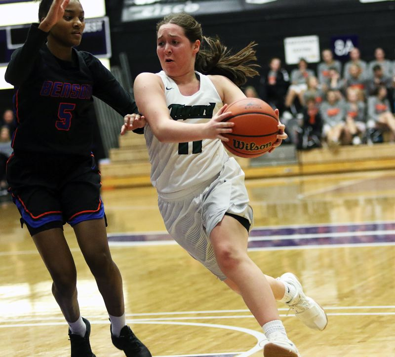 DAN BROOD - Tigard junior Paige LaFountain looks to drive to the basket against Benson's Tayler Lyday.