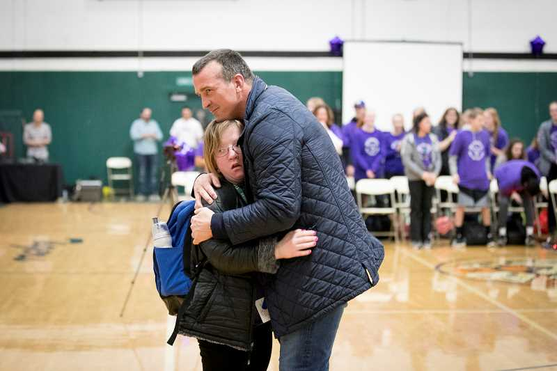TIMES PHOTO: JAIME VALDEZ - Former NBA player Chris Herren hugs a student at Tigard High School after speaking to the student body at the high school.
