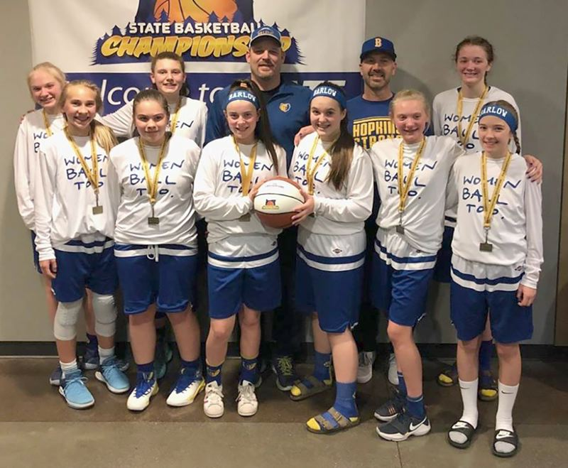 CONTRIBUTED PHOTO - Members of Barlows seventh-grade squad pose with their first-place medals after winning the middle school state title last weekend.