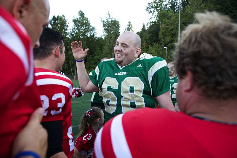 TIDINGS FILE PHOTO - Cote was a 2001 graduate of West Linn High School. He is shown here at the 2013 Battle for the Bridge alunmi football game.