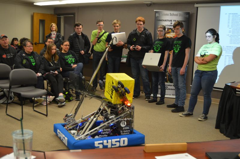 SPOTLIGHT PHOTO: NICOLE THILL - The St. Helens High School Robotics and Engineering Club gives a demonstration at a St. Helens School Board meeting Wednesday, Feb. 28.