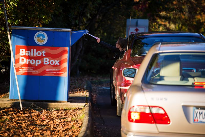FILE PHOTO - Voters drop off their ballots at a Washington County official drop box in Tigard in 2016.