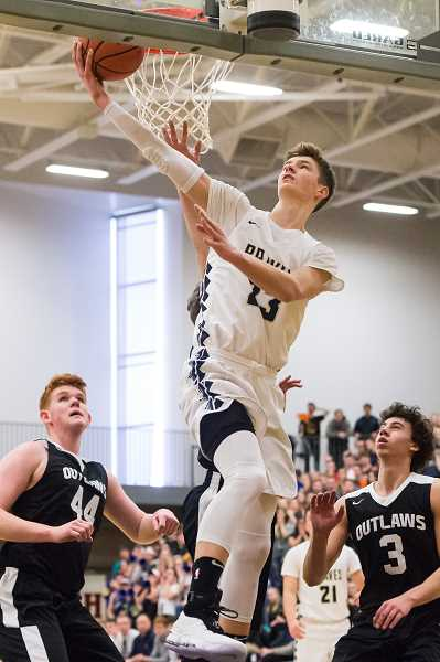 STAFF PHOTO: CHRISTOPHER OERTELL - Banks' Dalton Renne tries a reverse lay-in during the Braves' state quarterfinal game against Sisters March 8 at FGHS.