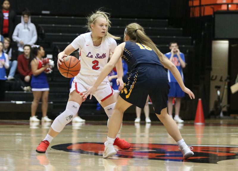 PAMPLIN MEDIA: JIM BESEDA - La Salle Prep's Emily Niebergall scored a game-high 11 points to help lead the Falcons to a 40-26 win over Bend in Thursday's OSAA Class 5A girls' basketball semifinal at Gill Coliseum.