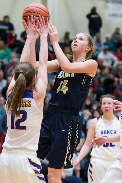 STAFF PHOTO: CHRISTOPHER OERTELL - Banks' Aspen Slifka goes up for a shot during the Braves' state quarterfinal against Baker March 8 at FGHS.