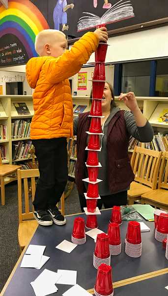 COURTESY OF DURHAM ELEMENTARY - Mrs. Anzmendi-Frias watches as her son, Easton, a kindergartener, particpates in the Stack the Cat's Hat activity.