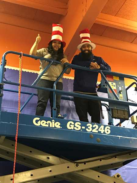 COURTESY OF DURHAM ELEMENTARY - Gidget Rivas, Durham's head secretary, and Armando Valenzuela, Durham's lead custodian, staff high above the crowd for the annual 'egg drop,' one of the most popular events of the annual STEAM night.