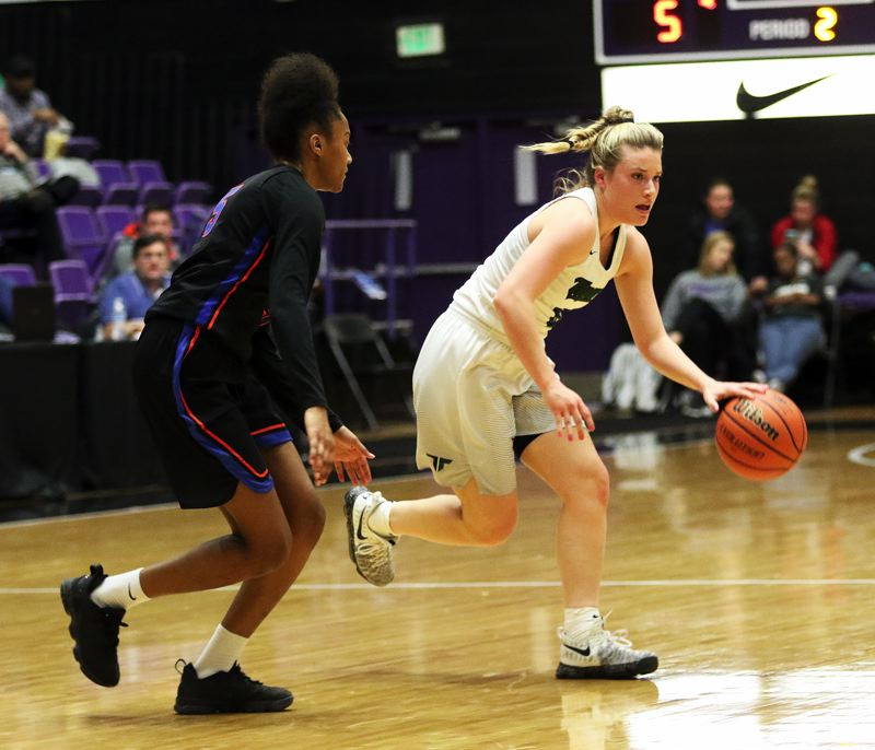 DAN BROOD - Tigard senior Gabby McGaughey (right) looks to dribble past Benson's Tayler Lyday during Wedensday's state tournament game.