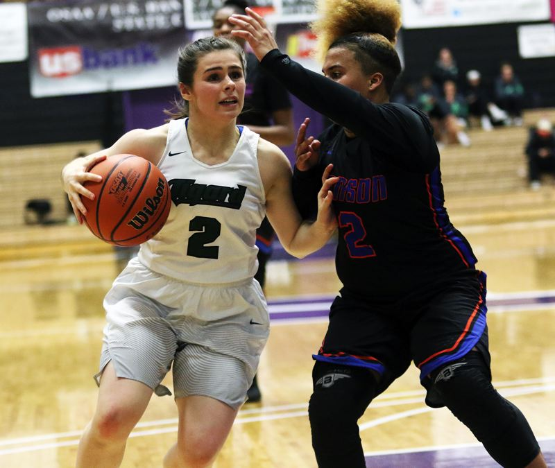 DAN BROOD - Tigard sophomore Kennedy Brown (left) looks to get past Benson junior Makenzy Porter.