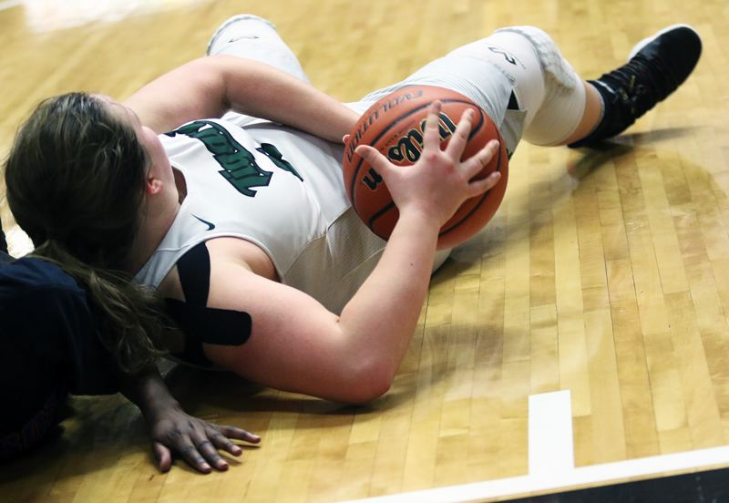 DAN BROOD - Tigard junior Dani Lyons hits the ground to control the ball during Wednesday's game.