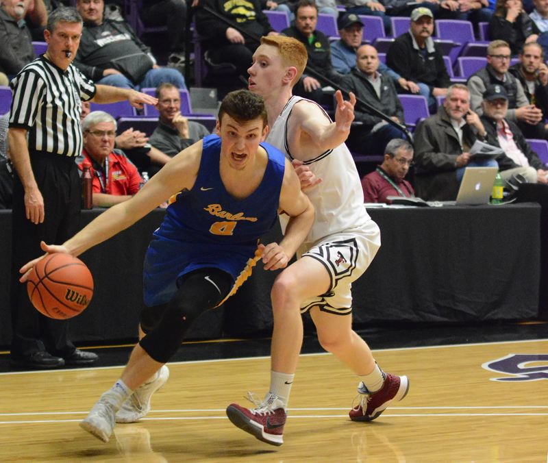 OUTLOOK PHOTO: DAVID BALL - Barlows Austin Forrar drives past a Tualatin defender for a layup and a 64-61 lead with two minutes to play.