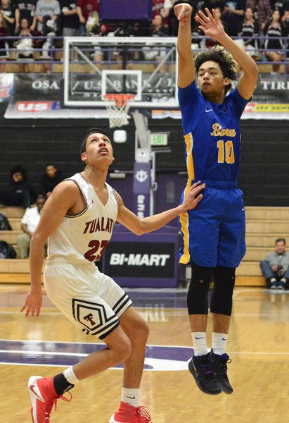 OUTLOOK PHOTO: DAVID BALL - Barlow's Daella Portin-Chapman fires a 3 over the top of Tualatin defender Alexis Angeles.