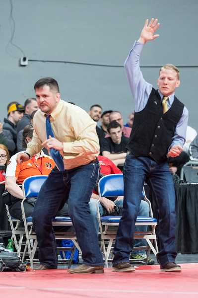 LON AUSTIN/CENTRAL OREGONIAN - Head coach Jake Huffman, left, and assistant coach Jake Gonzalez celebrate as Pacer Quire is about to capture the state 120-pound championship.