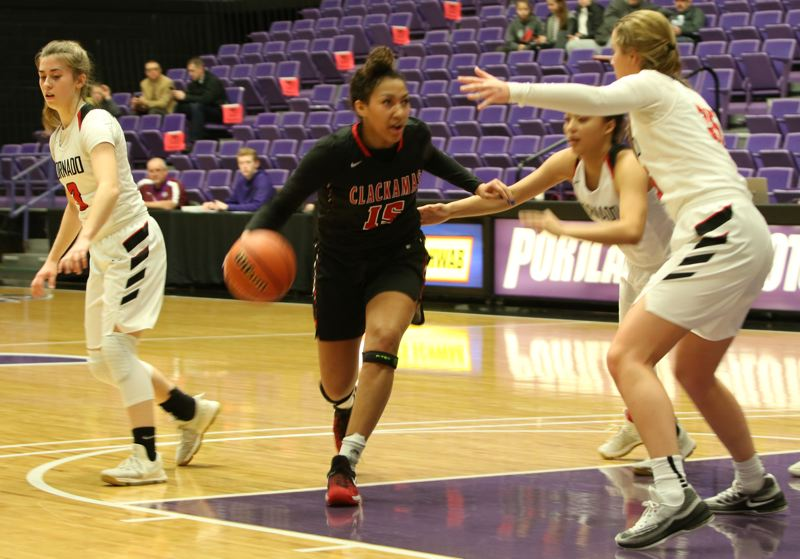 PAMPLIN MEDIA: JIM BESEDA - Clackamas' Kalani Hayes draws a double team as she drives the top of the lane in Thursday's OSAA Class 6A girls' basketball consolation game against North Medford at the Chiles Center.