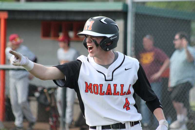 PIONEER FILE PHOTO - Molalla senior Kolten Jordan cheers on his teammates after scoring a run during a home game last season.