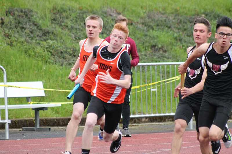 PIONEER FILE PHOTO - Molalla junior Tanner Nauta (front) takes the baton from junior Treyton Bierly (behind) during a meet at Wilsonville High School last season.
