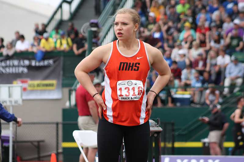 PIONEER FILE PHOTO  - Junior Katie Sandberg waits to throw the shot put at the state meet last season.