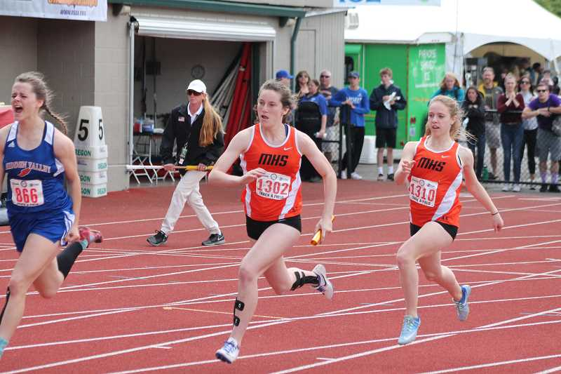 PIONEER FILE PHOTO - Molalla senior Emma Andrews left) takes the baton from junior Hannah Henderson during the 4x100 relay at the 2017 state championship meet.