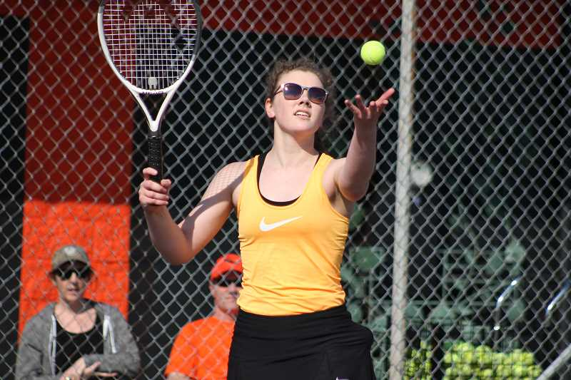 PIONEER FILE PHOTO - Country Christian senior Mollie Lewandowski prepares to serve the ball during a home meet last season.