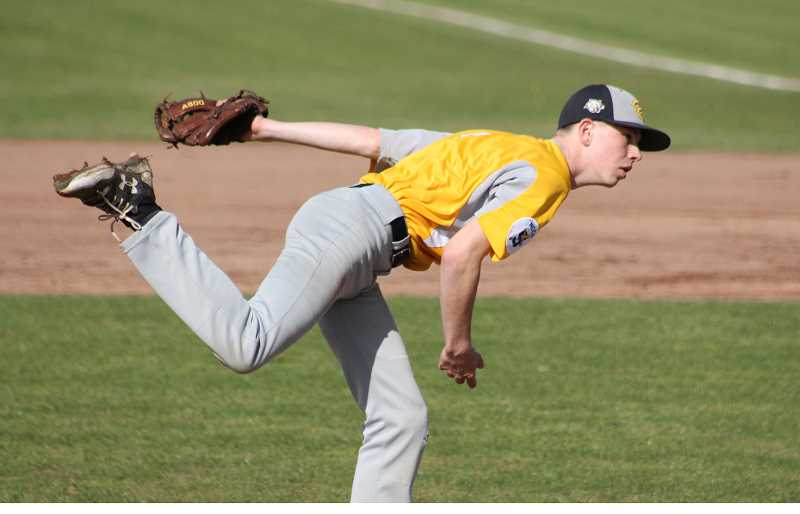 PIONEER FILE PHOTO  - Country Christian junior Drew Halverson delivers a pitch during a home game last season. Halverson will likely be the starting pitching for the Cougars this year and brings with him All-League honors.