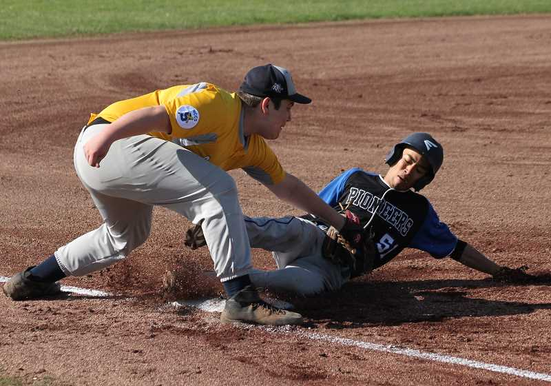 PIONEER FILE PHOTO  - Country Christian senior David Girrens tags out a runner at third base during a home game last season.
