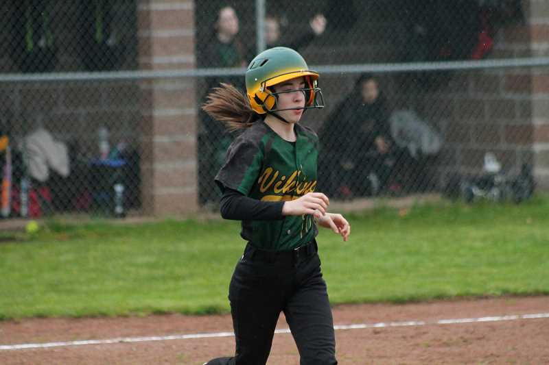 PIONEER FILE PHOTO  - Colton sophomore Madison Olsen runs to first base during a home game last season.