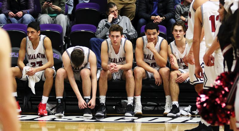 DAN BROOD - Tualatin's starting line-up of (from left) Alexis Angeles, Nathan Platter, Chris Freese, John Miller and Lucas Noland get ready for the quarterfinal game with Barlow.