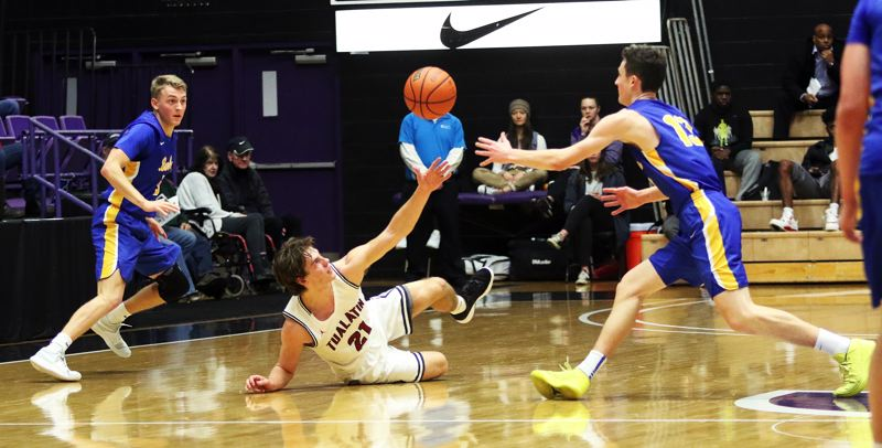 DAN BROOD - Tualatin senior Lucas Noland (21) tries to grab a loose ball during the Wolves' quartefinal game with Barlow.