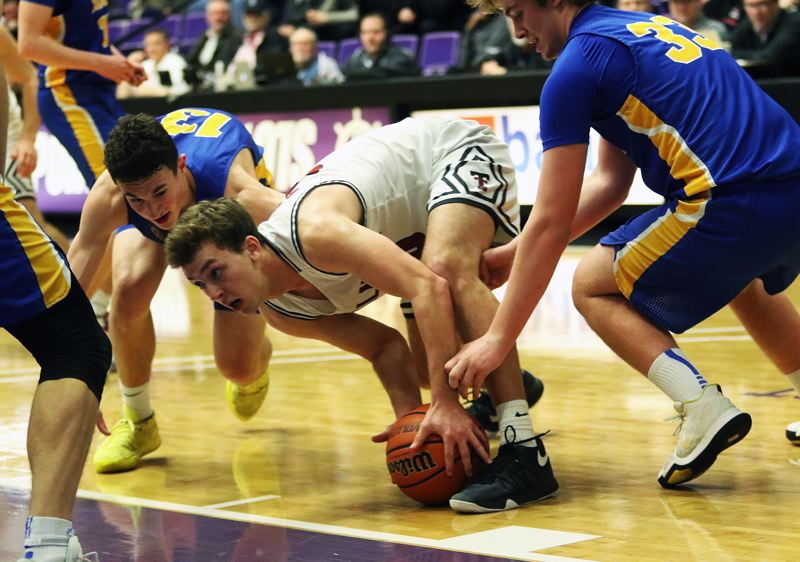 DAN BROOD - Tualatin senior Chris Freese gathers up a loose ball during the Wolves' game with Barlow.