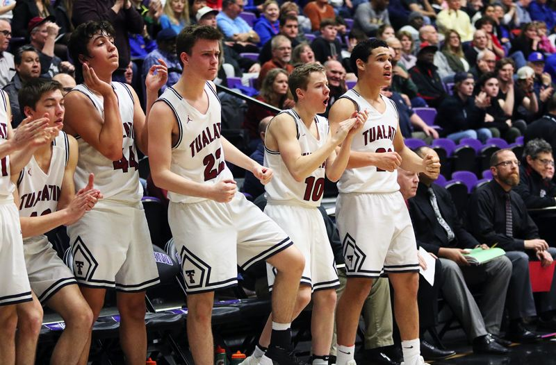 DAN BROOD - Tualatin's (from left) Matthew Kachlik, Bridger Steppe, Nathan Platter, Derek Levene and John Miller cheer following a key play in the Wolves' state tournament quarterfinal game with Barlow.