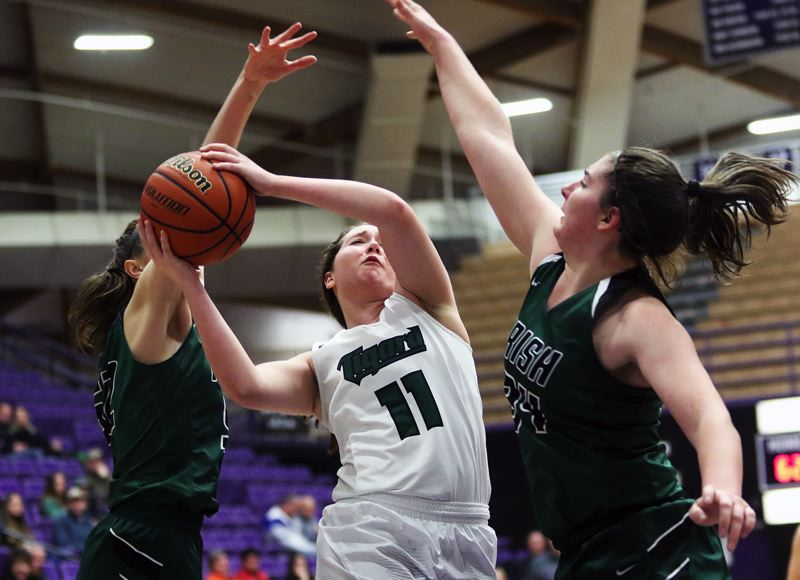 DAN BROOD - Tigard junior guard Paige LaFountain goes up to the basket between Sheldon's Fallon Hanson (left) and Emma Neuman during the Tigers' 65-51 state tournament win.