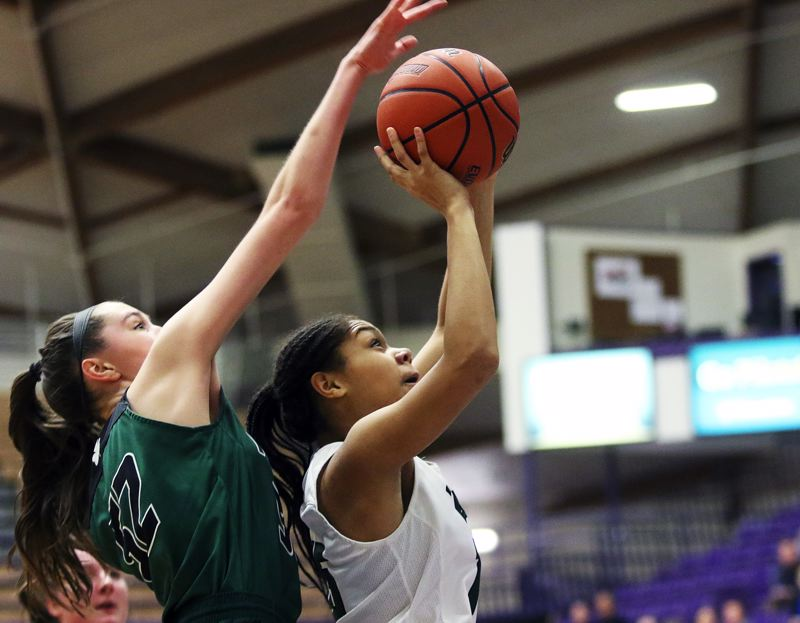 DAN BROOD - Tigard freshman Ajae Kadel (right), with Sheldon's Amber Winkler behind her, goes up for a shot during the Tigers' 65-51 state tournament victory.