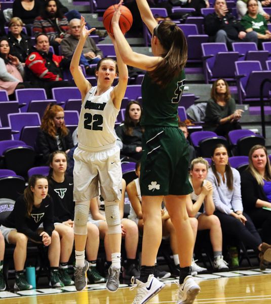 DAN BROOD - Tigard sophomore Delaney Leavitt (left) shoots over Sheldon's Amber Winkler during the Tigers' state tournament win on Thursday.